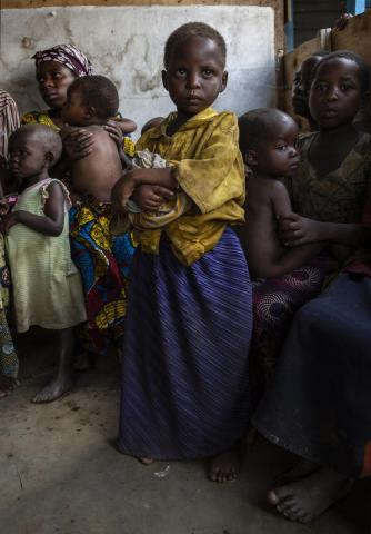 5-year-old Havugimana waits to be screened for malnutrition in the Democratic Republic of the Congo