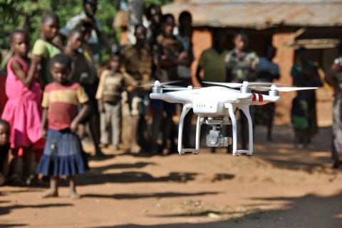 A drone takes off during a demonstration for residents in Thipa vllage, Kasungu District, Malawi.