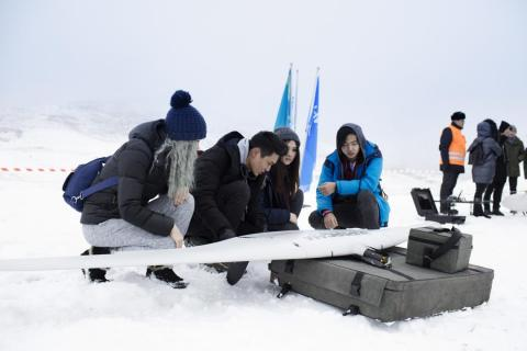 Students from UNICEF Innovations Lab study UAV during drone testing for search and rescue operations in Kazakhstan