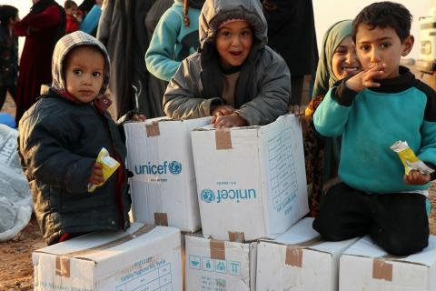 Children in Rukban camp, Syria, with aid delivered by UN humanitarian convoy