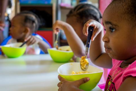 Children eat their lunchtime meal at the Shining Star Nursery, which is owned and run by Claudette Thompson in Buckley's Estate in Basseterre on St. Kitts, St. Kitts and Nevis, Tuesday 11 July 2017.