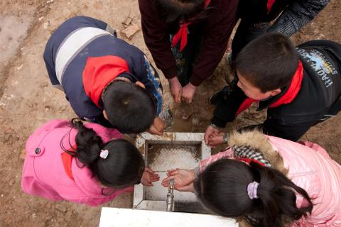 Boys and girls wash their hands during recess at Caochuan Primary School, Xihe County, Gansu Province, China.