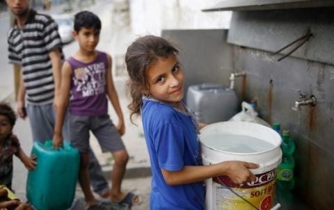 Water crisis: A girl collects water in Gaza, State of Palestine