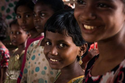 Children smile in a refugee camp in Bangladesh