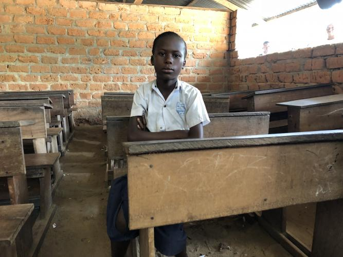 A girl sits at a desk, Democratic Republic of Congo
