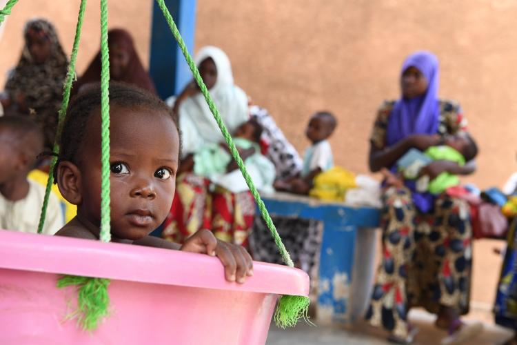 Niger. A baby is weighed and measured at a health center in Maradi.