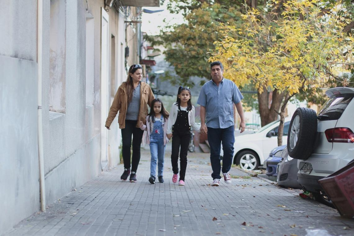Uruguay. A family walks down a street.