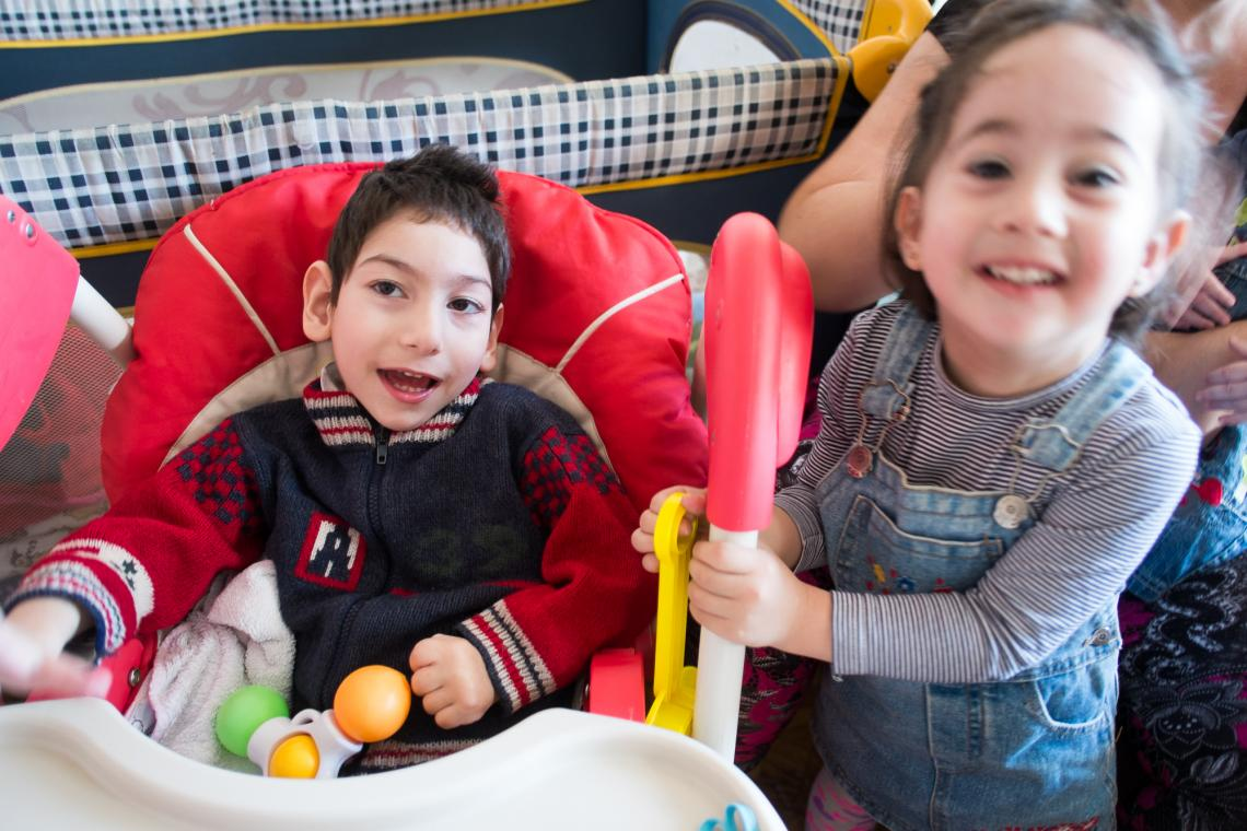 Tsotne, 5, and Elizabeti, 2, in their family's apartment.