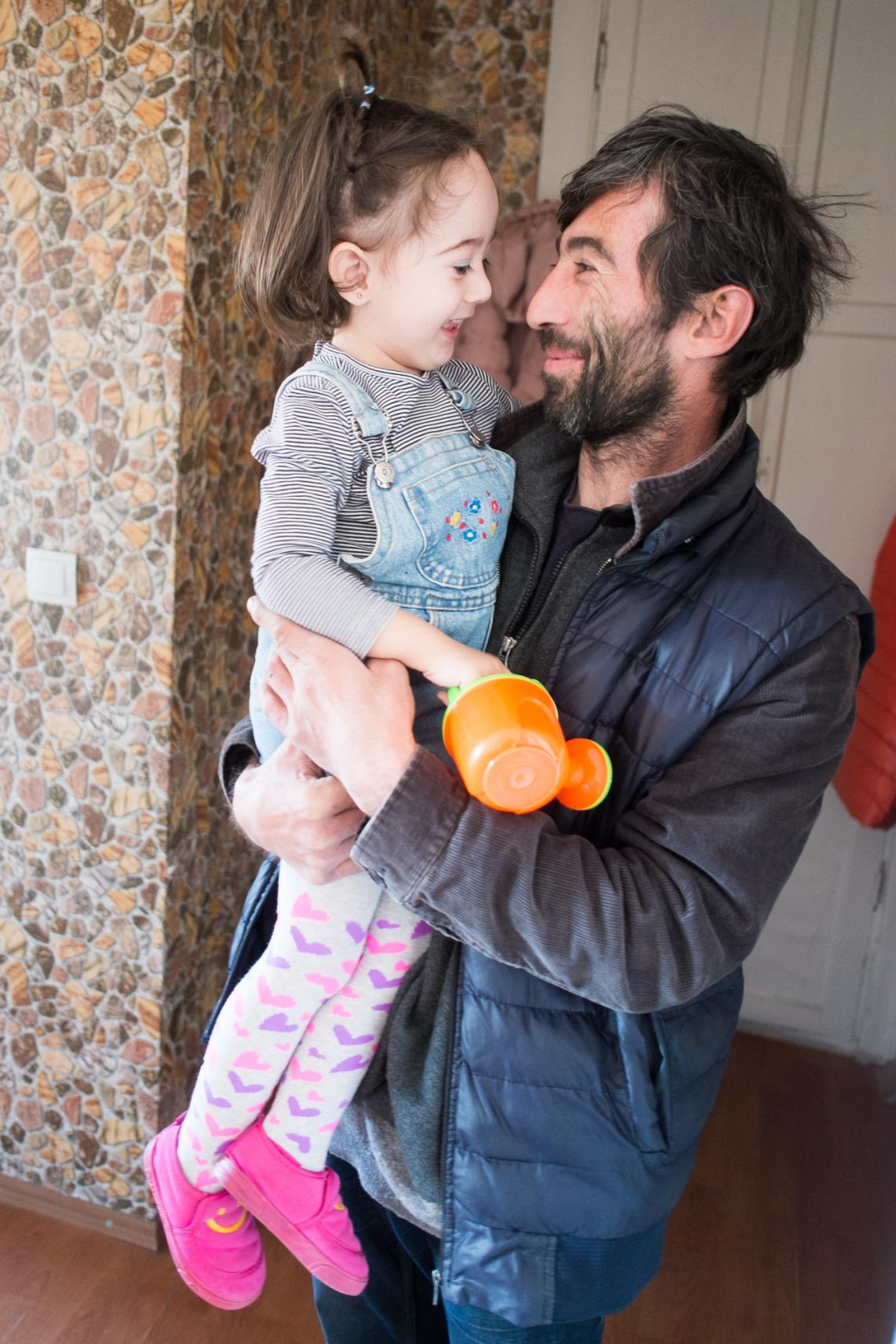Elizabeti's jumps into the arms of her father
