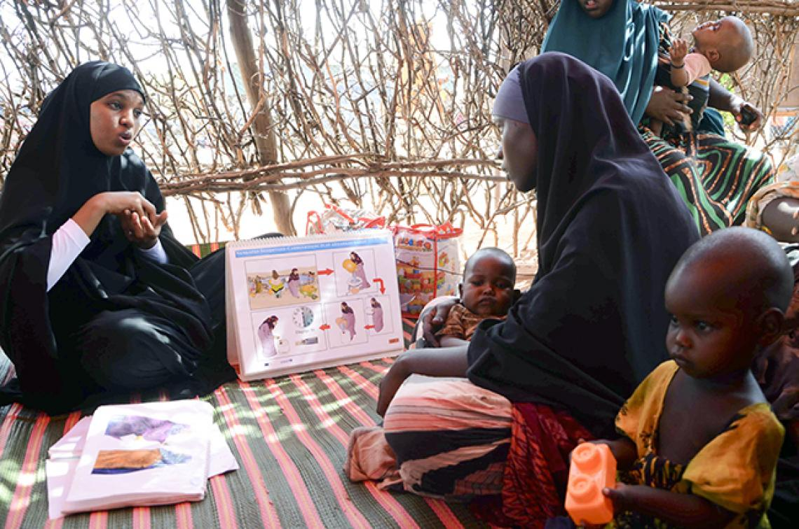 Mothers receive nutrition and hygiene advice from a health worker in Somalia