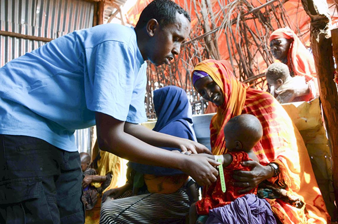A child's nutrition status is assessed at a UNICEF-supported outpatient therapeutic feeding centre in Dolow, Somalia.