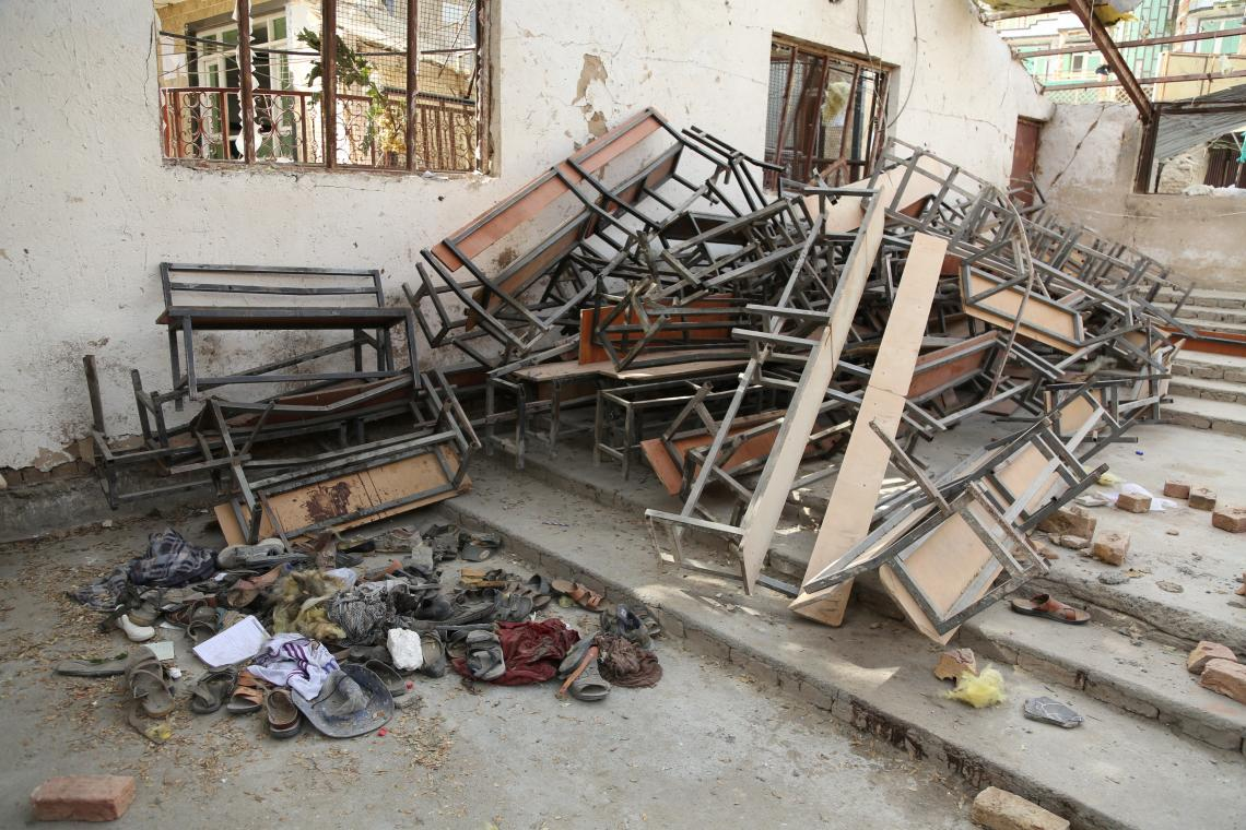 Belongings of students in one side of a destroyed classroom, Afghanistan