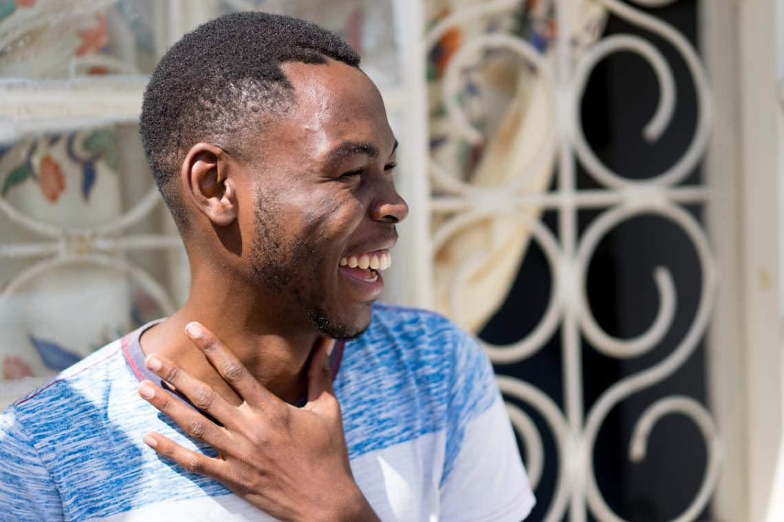 A teenage boy laughs, Mozambique