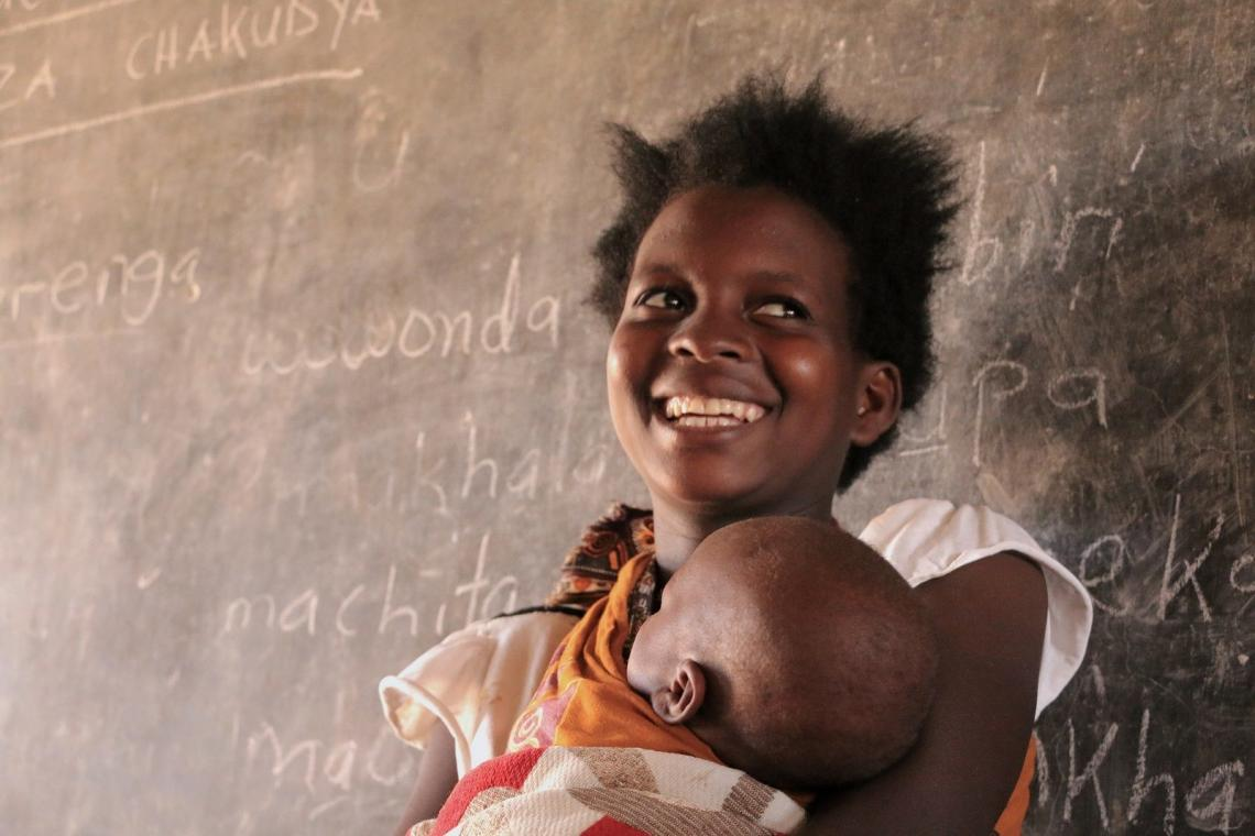 A mother holds her child in Malawi