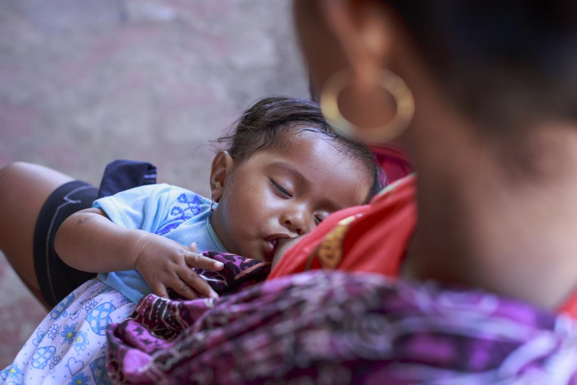 A baby breastfeeds in Timor-Leste