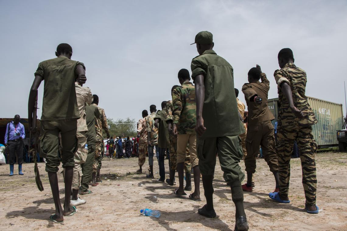Children in uniform march in lines, South Sudan