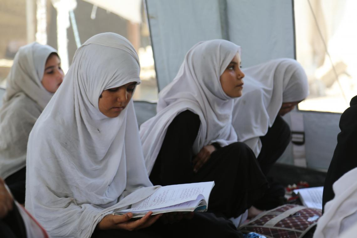 Girls studying in Afghanistan in a tented school.