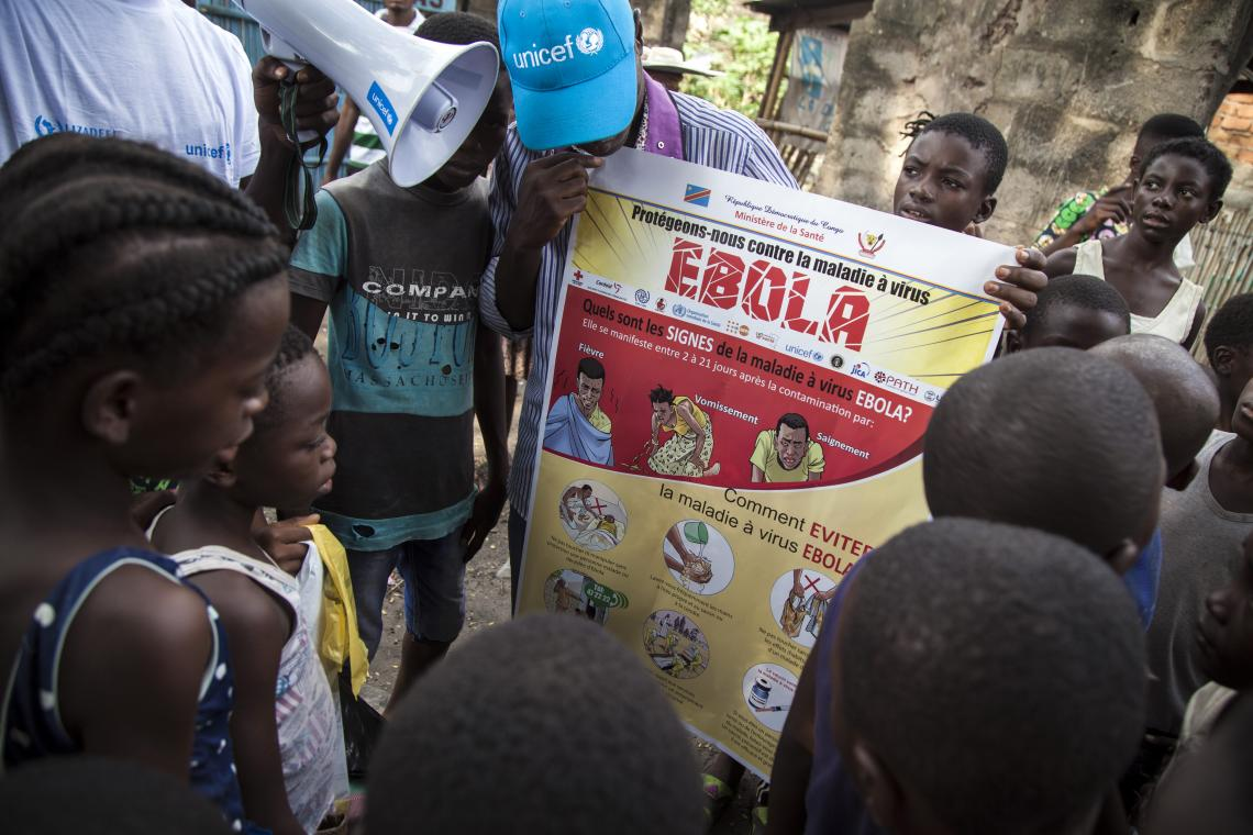 Children look at a poster about Ebola, Democratic Republic of the Congo