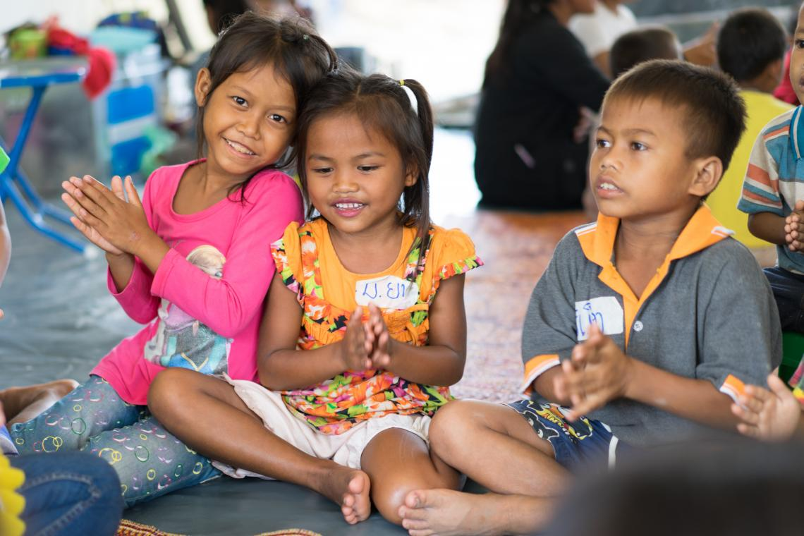Children enjoy a singing activity in a UNICEF-supported Child Friendly Space in Ban Bok camp, Attapeu, Lao PDR.
