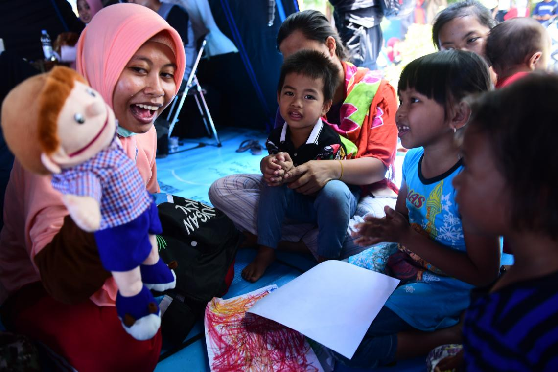 Children affected by the tsunami in Indonesia participate in activities aimed at helping them deal with with the shock.