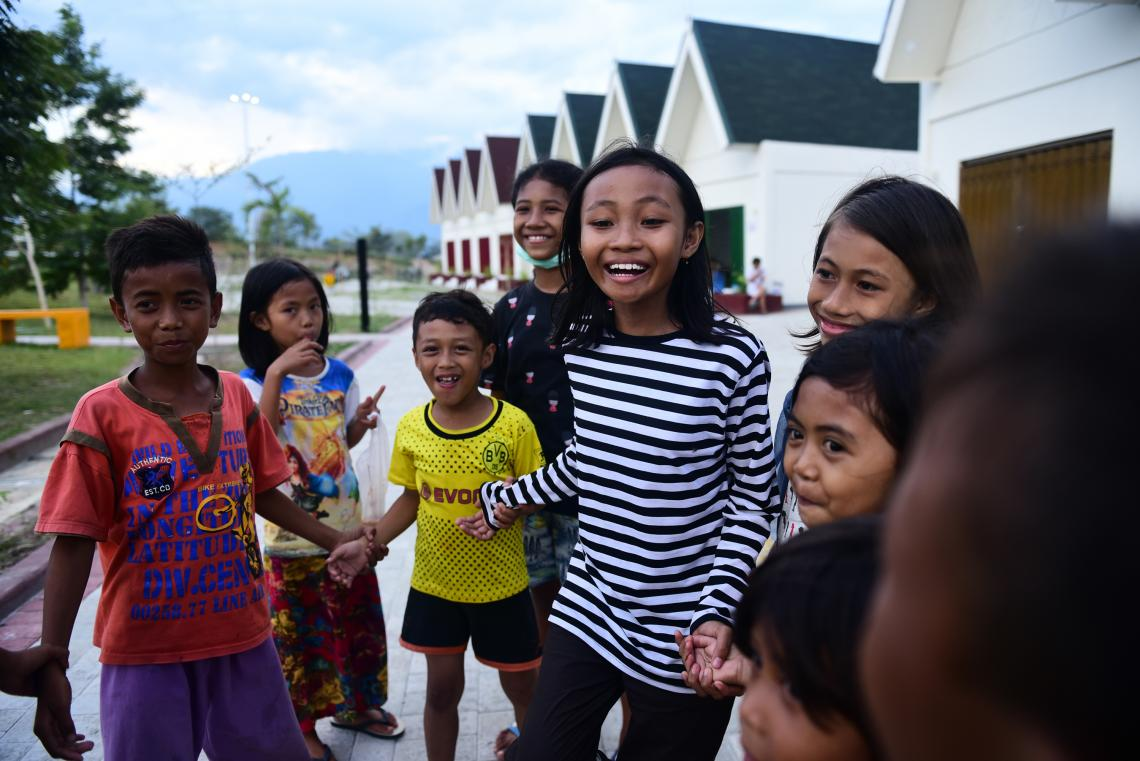 Indonesia earthquake and tsunami. Students outside their temporary school.