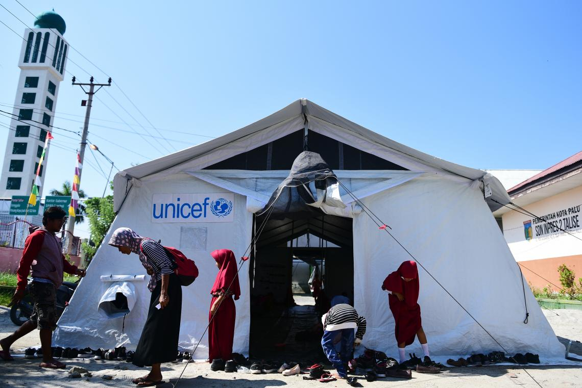 Indonesia earthquake and tsunami. Students outside their temporary UNICEF school tent.