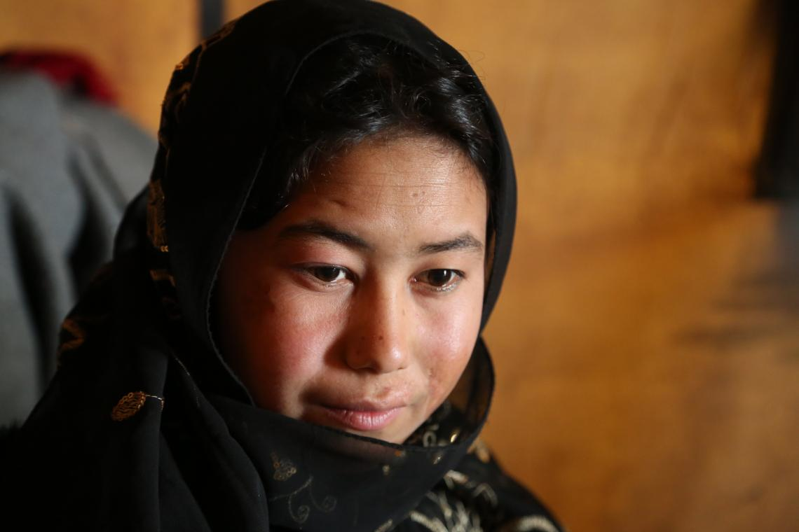 Afghanistan. A girl sits at the Zaimati IDP settlement.