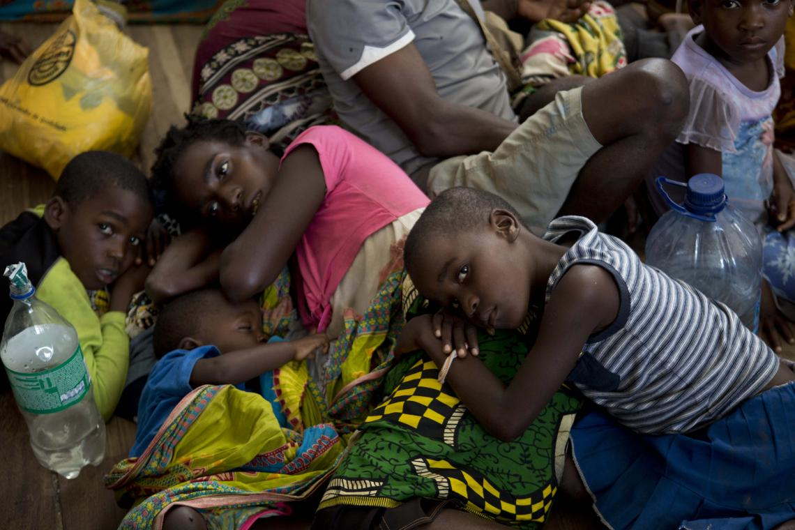 Mozambique. A group of people displaced rest at a school.