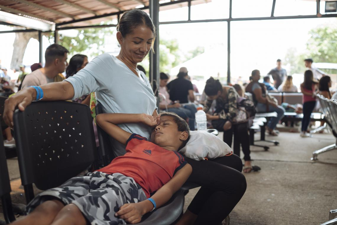 Cucuta. A boy rests on his mother's lap at a migration centre in Cucuta, Colombia, at the Colombian-Venezuelan border.