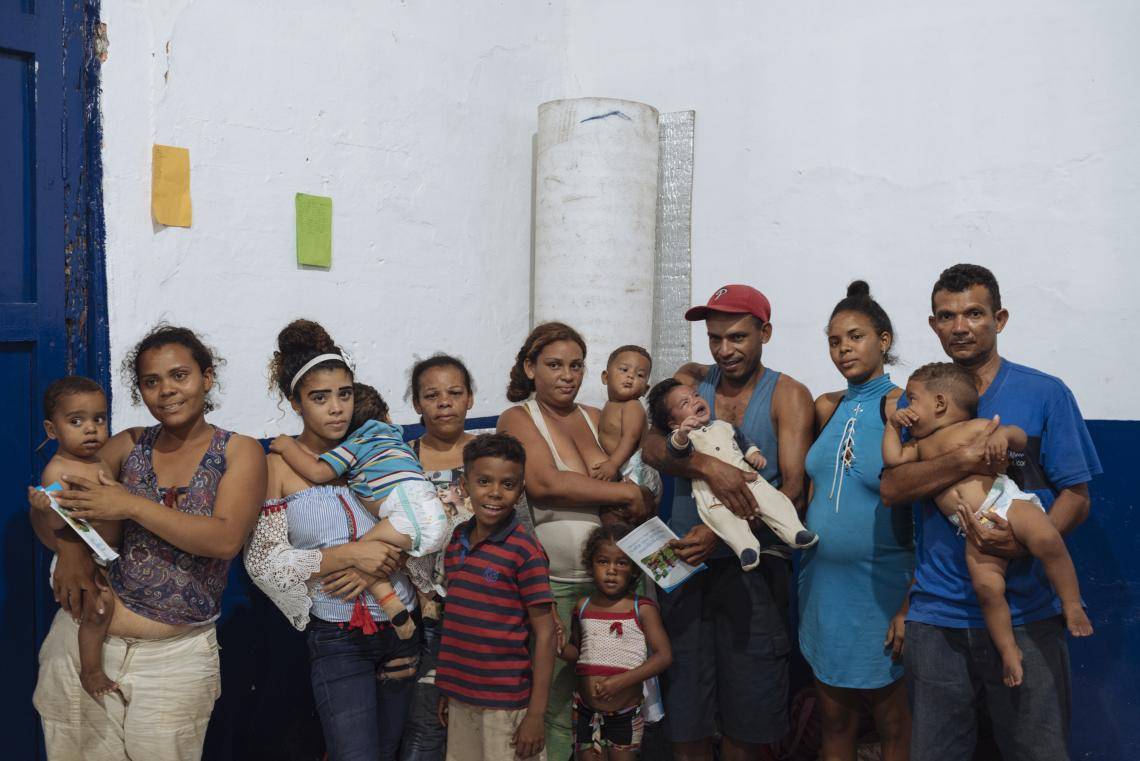 Colombia. A family stands in an accommodation centre.