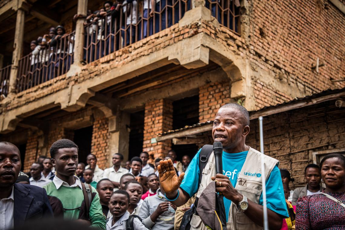 Democratic Republic of Congo. A UNICEF Communications for Development (C4D) officer talks to students at La Vérité school, as part of a sensitization campaign to raise awareness of Ebola in Butembo.