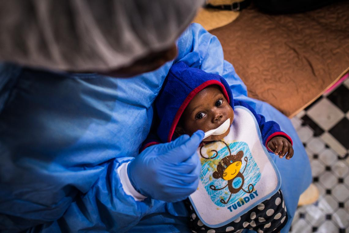 Democratic Republic of Congo. A caregiver at the Ebola Treatment Centre of Butembo, feeds a baby at a nursery for young children affected by the virus in North Kivu Province.