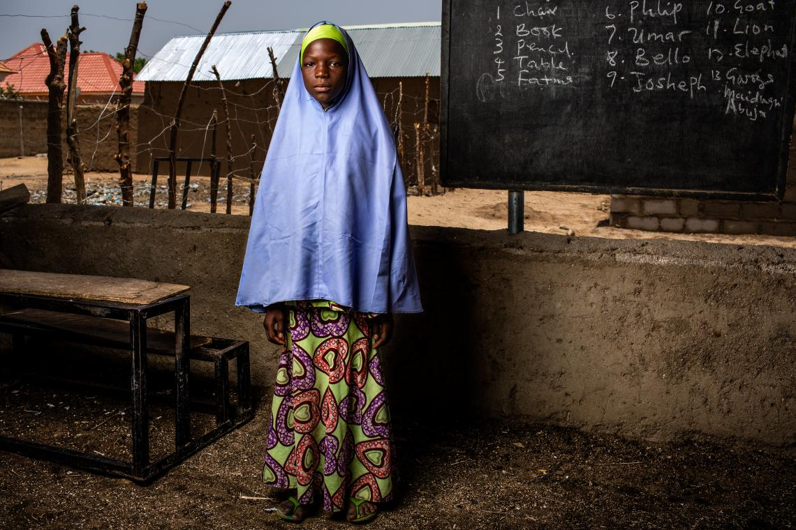 Nigeria. A girl stands in an open-air classroom at Sabo Garawi Primary School in Gwoza, northeast Nigeria.