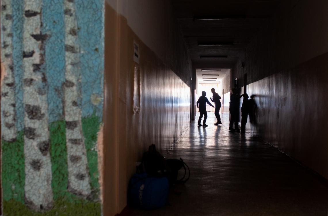 Ukraine. Children stand in the hallway of a school.