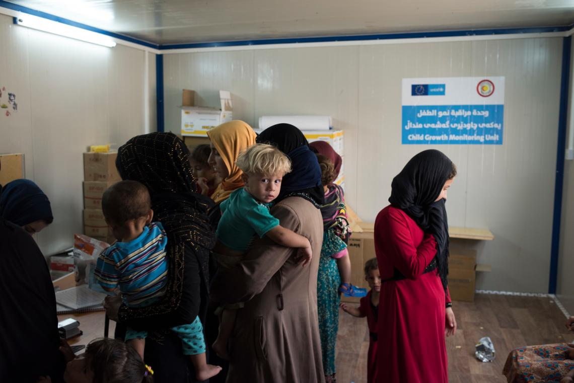 Mothers bring their children to a UNICEF-supported growth and nutrition monitoring unit, or 'baby hut', in Debaga camp.