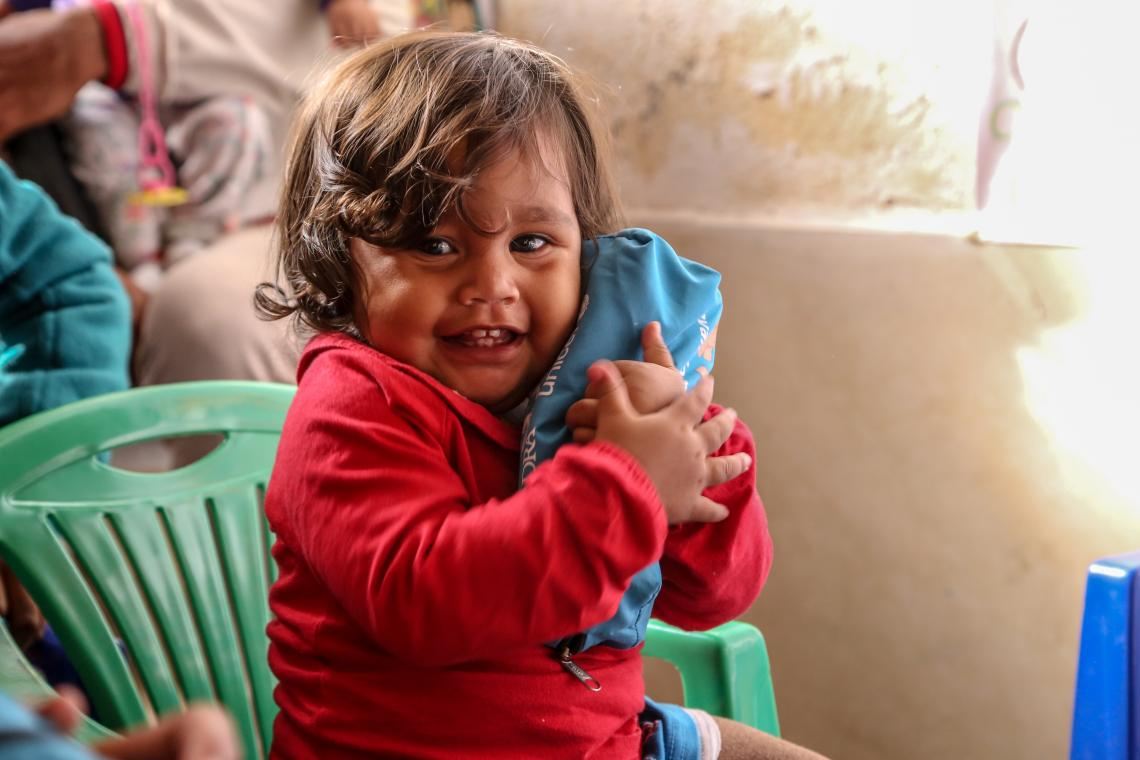 Ecuador. A young girl sits in a UNICEF-supported child friendly space.