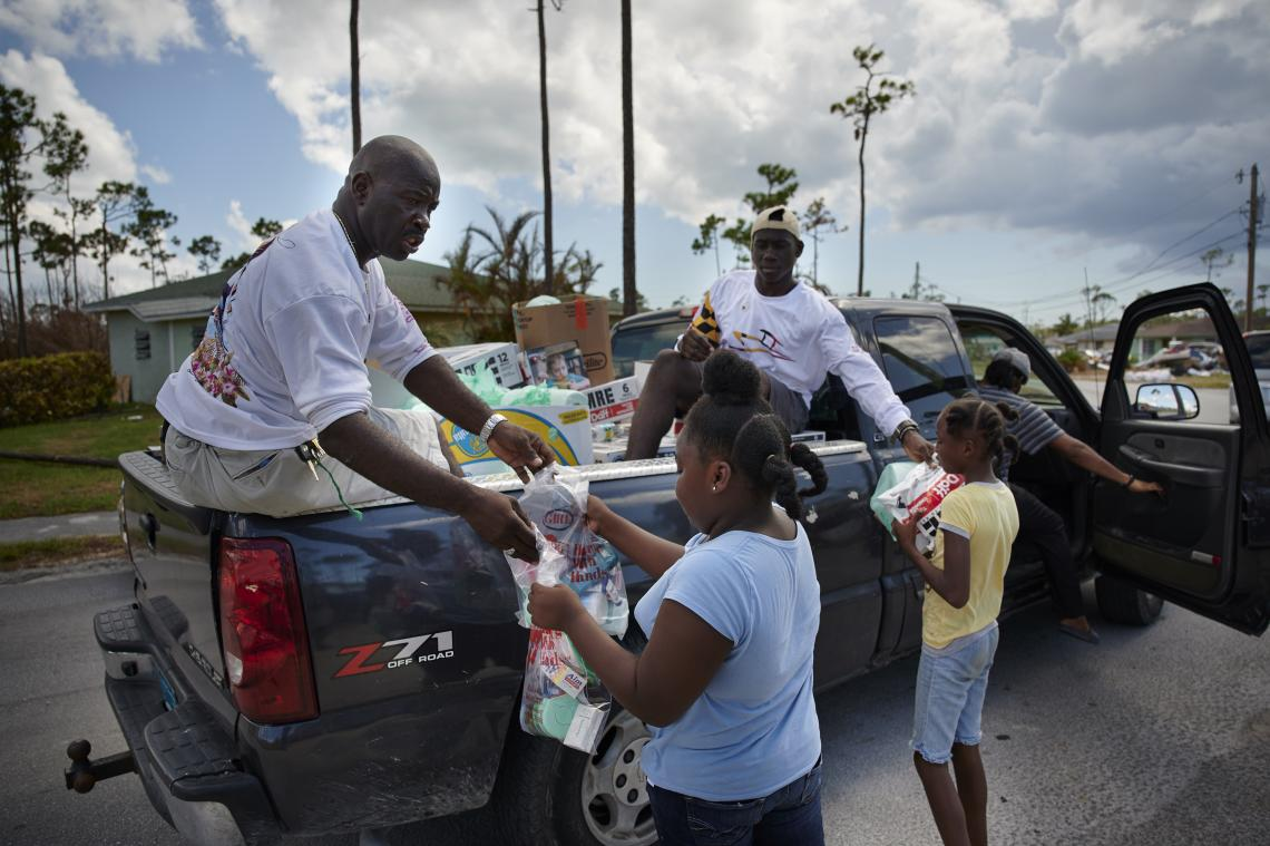 People collect supplies from a NGO on Grand Bahama.