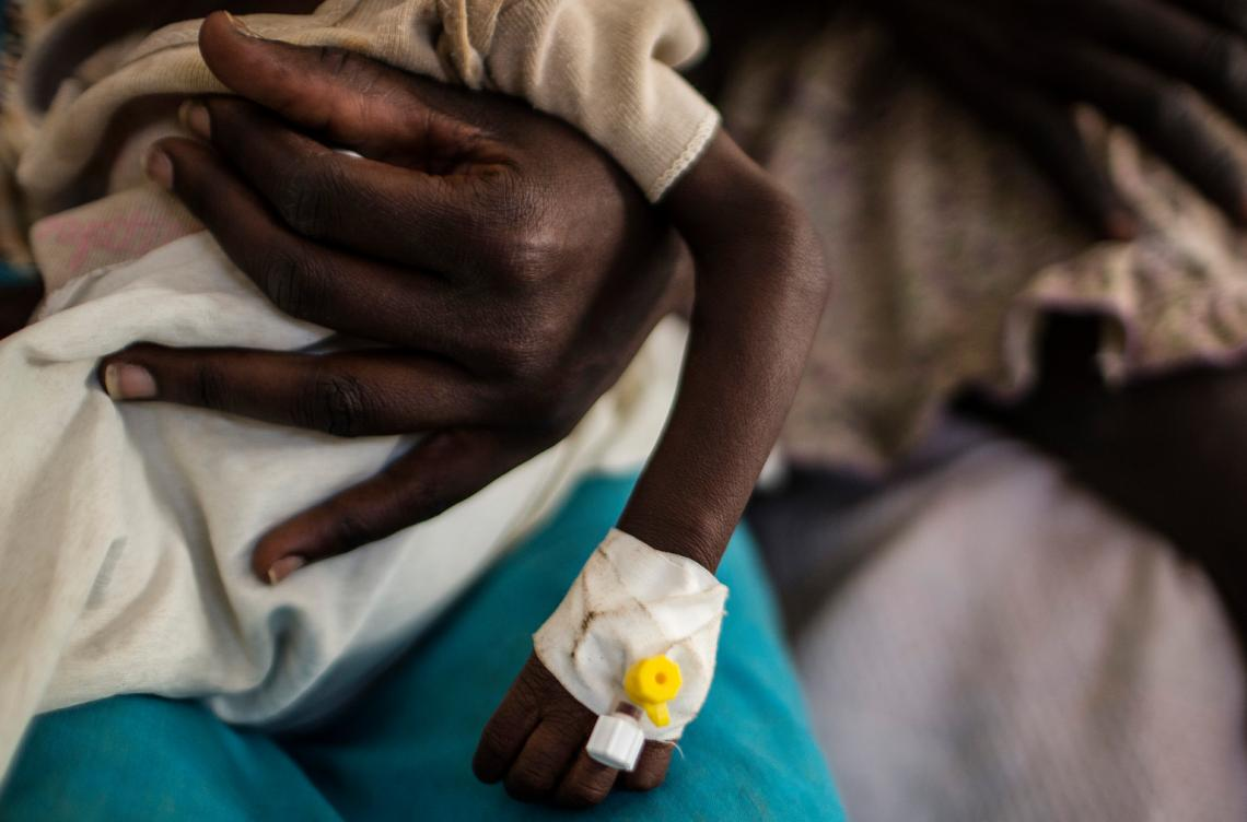 A woman holds a child in a UNICEF supported hospital in Juba, South Sudan.
