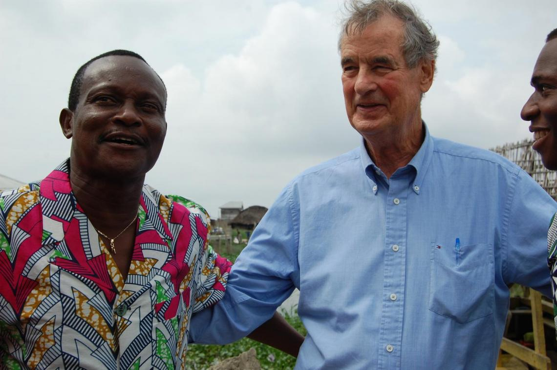 Benin, West Africa: Nicolas and Denis hug after seeing each other for the first time in 45 years.
