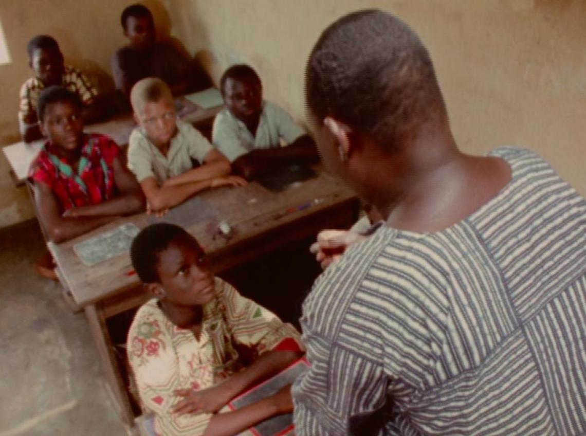 Education in Benin, West Africa: a teacher talks to a class of students.