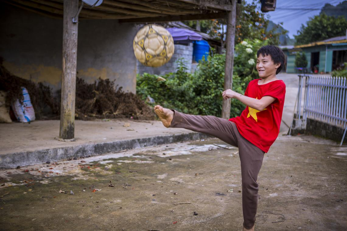 Viet Nam. A boy plays football in the backyard of his home in Lao Cai province in Viet Nam.