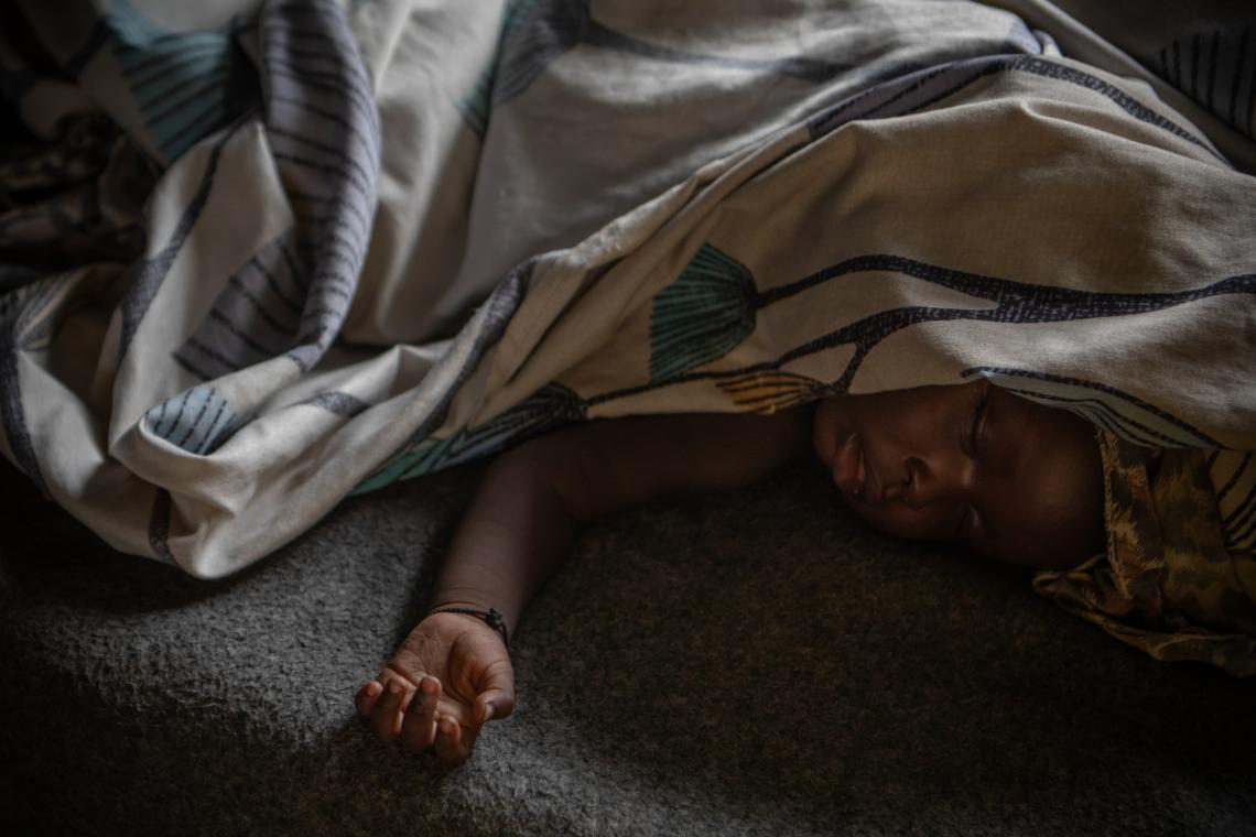 South Sudan. A baby sleeps on a cot in a primary school classroom that has been converted into a shelter for some of those displaced by flooding in Pibor, South Sudan.