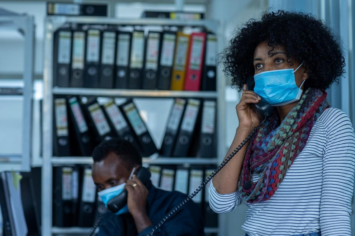 Ethiopia. A social worker talks on the phone.