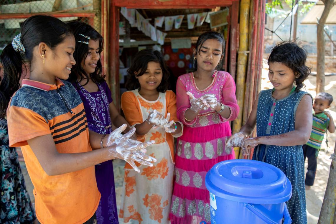 Bangladesh. Rohingya children wash their hands.