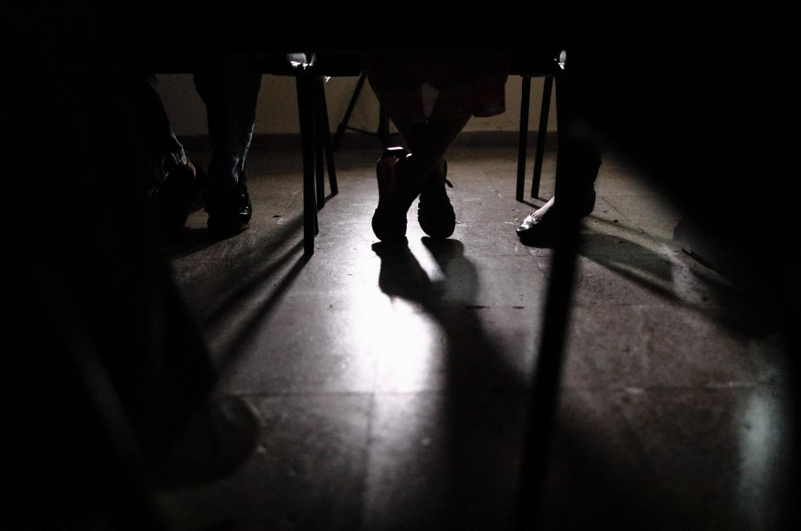 Silhouette of shoes under a table, El Salvador