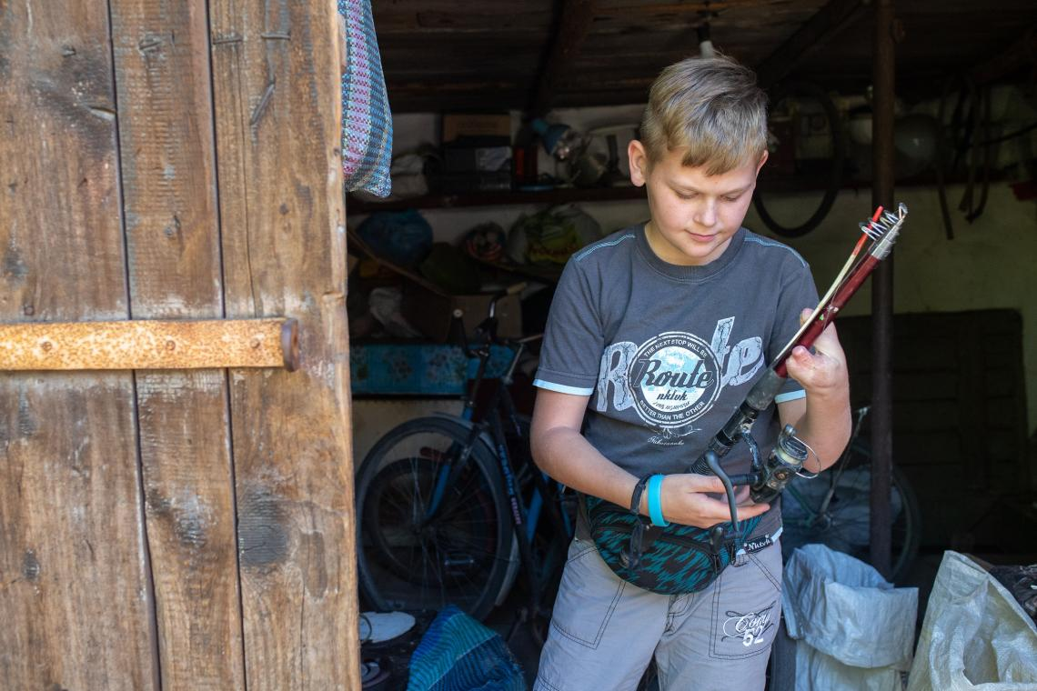 Ukraine. A boy holds a fishing rod.