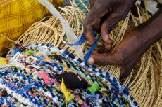 A basket being woven by Abane Afana-An using bark and recycled colth and plastic bags in Nyariga in the Upper East Region of Ghana on 27 May 2015.