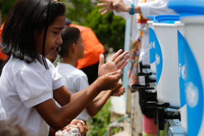 Venezuela. Children learn how to wash their hands properly with soap and water during an activity supported by UNICEF in a school located on the outskirts of Caracas.