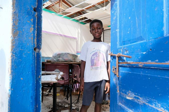 On 11 September, Tiquani Lewis, 9, stands in a damaged classroom at Adrian T. Hazell Primary School, in South Hill District, on the island of Anguilla – which was hard hit during Hurricane Irma.