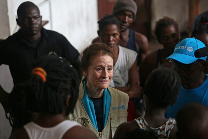On 22 March 2019 in Beira in Mozambique, (centre) UNICEF Executive Director Henrietta H. Fore speaks with internally displaced people as she visits a secondary school used to shelter evacuees from Cyclone Idai.